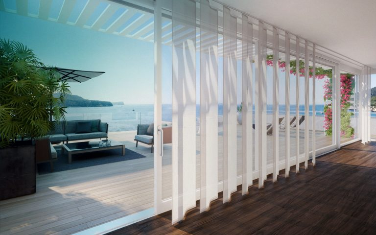 Silent Gliss Wave Curtain Tracks on huge french windows at a Villa, leading out to decking with a sea view